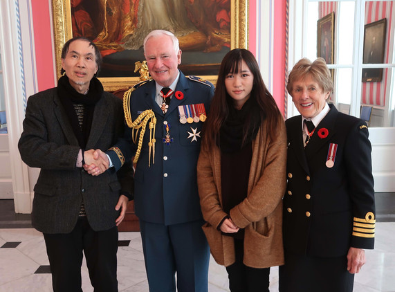 Olivia and her father Xiangming Zeng, a renowned artist, were invited by the Royal Canadian Legion to Canada's capital Ottawa where they met The Right Honourable David Johnston (28th Governor General of Canada) and his wife Sharon Johnston at Rideau Hall.