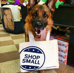 "A happy German Shepherd proudly displays his ""Shop Small"" small business tote bag"