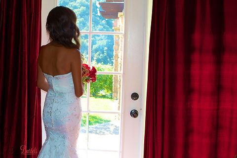 Bride with flowers at window