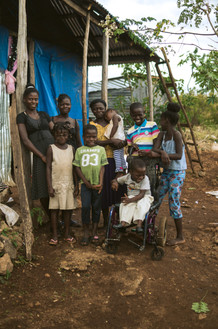 Cooperative Family- Why are women in the Haiti Village Project recipients of microloans?  Women spend their loans on improving their lives. Women are historically better at repaying their loans. Loans given to women are making lives better for them and their families.