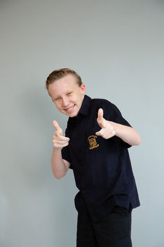Teenage boy giving thumbs up in cheeky talent photoshoot with Angela Scott photographer