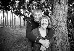 Happy couple hugging in a forest location professional photo shoot