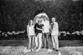 Location family photo shoot with pets in black and white