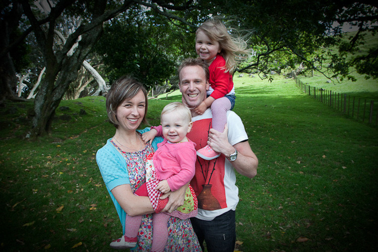 Outdoor location photo with family and kids in the park wearing colourful clothes by Angela Scott photographer