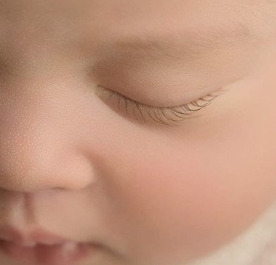 Close up of newborn baby face details in studio photoshoot