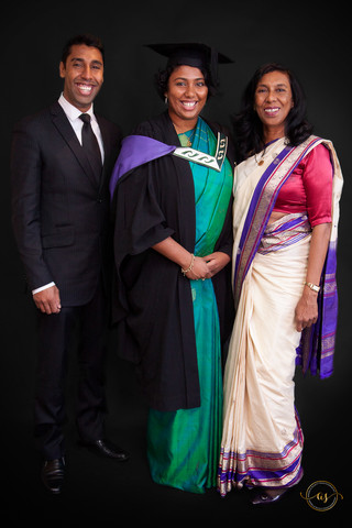 Studio graduation portrait full length daughter and parents
