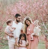 Outdoor location family photo shoot with blossom trees