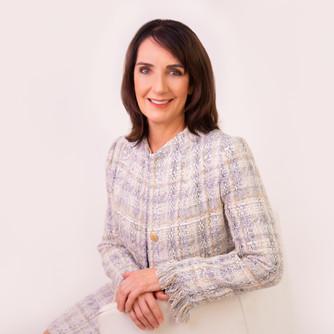 Professional studio business portrait of a lady in a jacket by Angela Scott