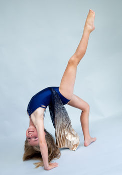 Girl doing gymnastics handstand during modelling and acting talent photoshoot in the studio of Angela Scott photographer
