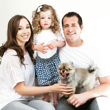 Studio family portrait with a young child and a dog with professional Auckland photographer Angela Scott