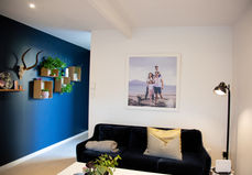 Beach professional family portrait framed and hanging on the wall in the lounge by Angela Scott photographer