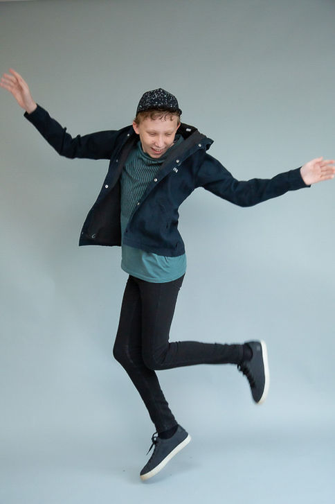 Teenage boy jumping in a studio photoshoot for his talent acting portfolio photographed by Angela Scott