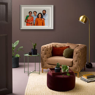 Reading nook with a framed family portrait on the wall
