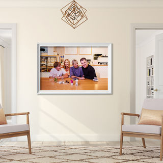 Room with two chairs and a beautiful location family portrait