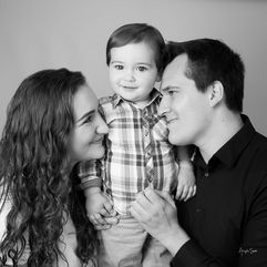 Young family in the studio black and white close up with toddler