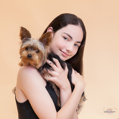 Girl with yorkshire terrier dog in a professional studio pet photo by Angela Scott photographer.