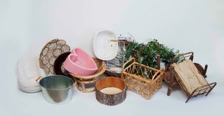 A small selection of beds, baskets, bowls and wreaths available for photoshoots of babies and newborns in the studio