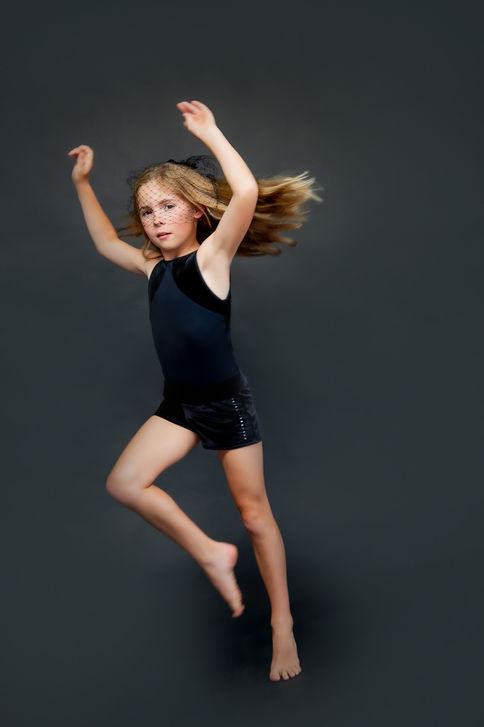 Girl posing for a professional talent photoshoot in Auckland studio of Angela Scott photographer