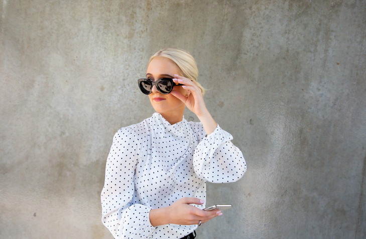 Location chic modern professional business portrait photo of lady in shirt and sunglasses by Angela Scott Photography