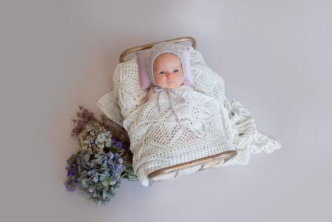 Newborn baby photo in a bed in the studio