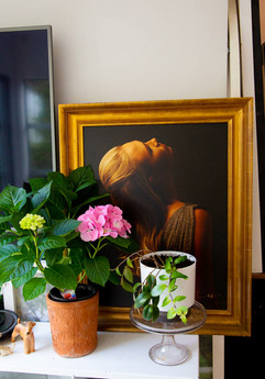 Flowers and photo in frame at studio of Angela Scott Photography