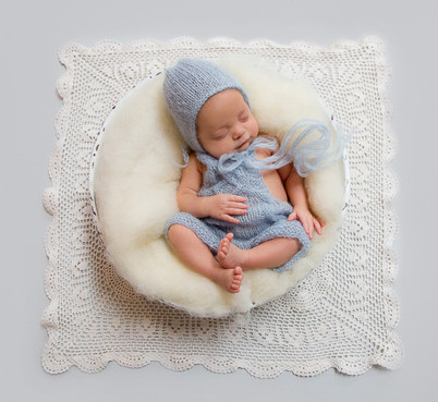 Very cute baby photo of newborn child asleep in a basket