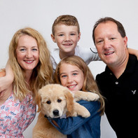 Professional family photo with pet dog puppy by ANgela Scott photography