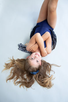 Girl lying down in studio for professional modelling photoshoot with Auckland photographer Angela Scott