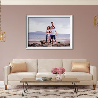 Lounge with beach family portrait on display