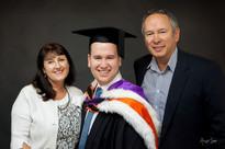 Graduation photoshoot in studio with parents by professional photographer Angela Scott