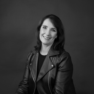Black and white professional studio business portrait of a woman in black jacket by Angela Scott photographer