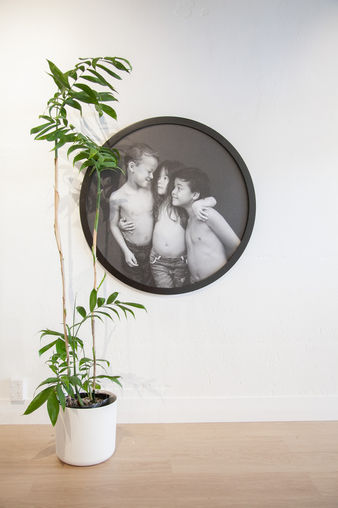 Framed circular portrait of children in black and white by Angela Scott photography