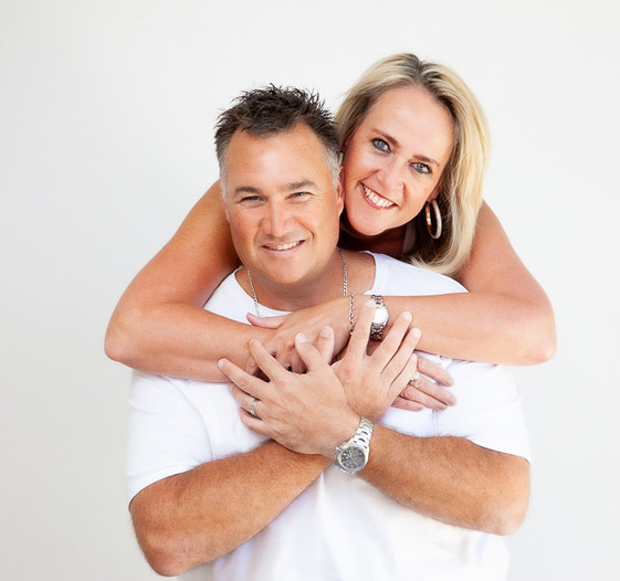 A couple hugging in a studio couples portrait with Angela Scott photography