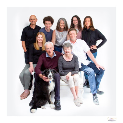 Extended family photoshoot in the studio with grandparents and border collie dog. Image by Angela Scott