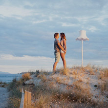 Beautiful location beach photoshoot with a couple and a light stand