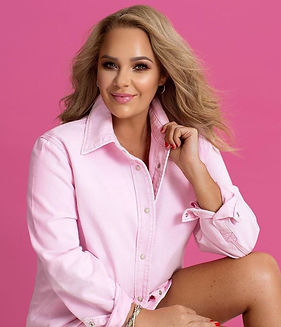 Woman in pink showing professional clothing styling