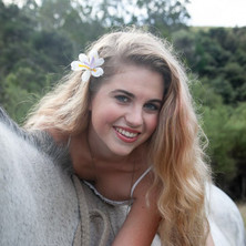 Photo of a young woman with her horse on location by ANgela Scott photography