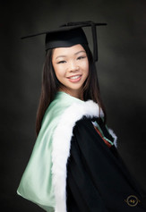 Professional graduation portrait in the studio with robe and mortar board cap taken by Angela Scott photographer