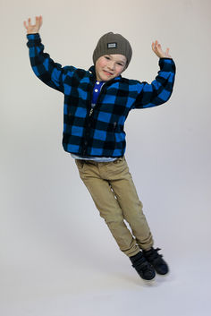 Boy jumping for a professional acting photoshoot in Angela Scott Photography studio