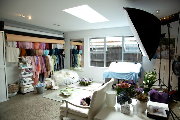 Interior view of the photo studio showing some of the props and backgrounds available for creative and fun photoshoots with Angela Scott