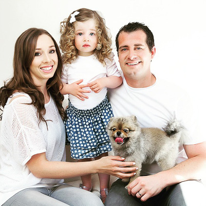 Fun modern professional studio family photoshoot with puppy by Angela Scott photography