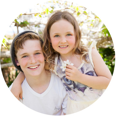 Children photographed outdoors on location with flowers close up, in Auckland by Angela Scott photography