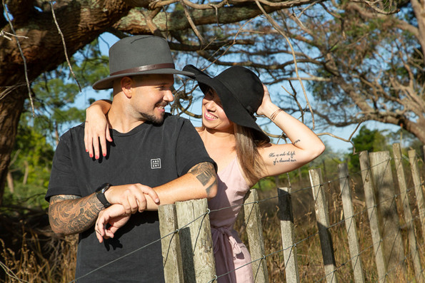 Location fun couples photoshoot outdoors with hats by Auckland photographer Angela Scott