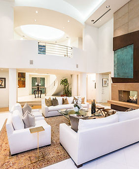 Modern living room with white couches
