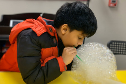 Anish blowing bubbles for Fun Friday