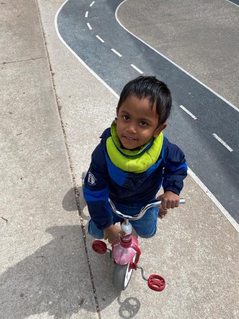 Ishaaq riding trike