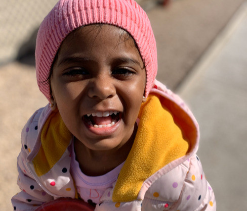 Afrin enjoying outdoor play time