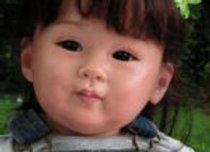 Criança reborn chun mei