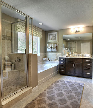 Large ensuite bathroom with separate shower and tub and two separate vanities