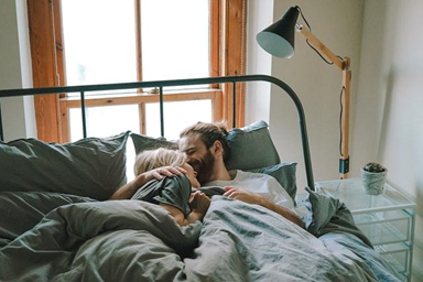 COUPLE'S LAZY DAY IN BED.